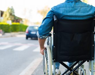 Disabled man preparing to go across the road
